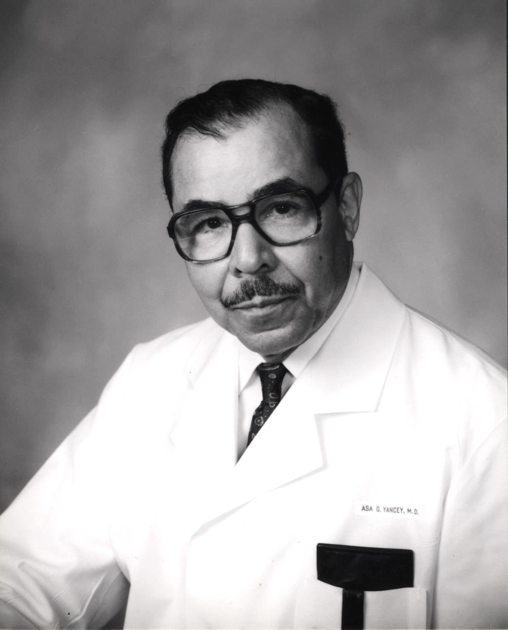 Asa Yancey, MD in white coat