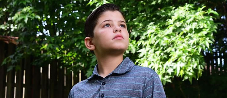 BOYHOOD DISRUPTED: When 9-year-old Brayden Harrison fell out of a tree, his life was saved by Emory pediatric neurosurgeon Andrew Reisner