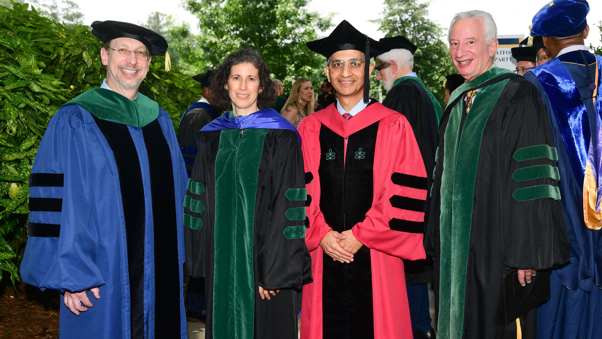 Dean and leadership in cap and gown