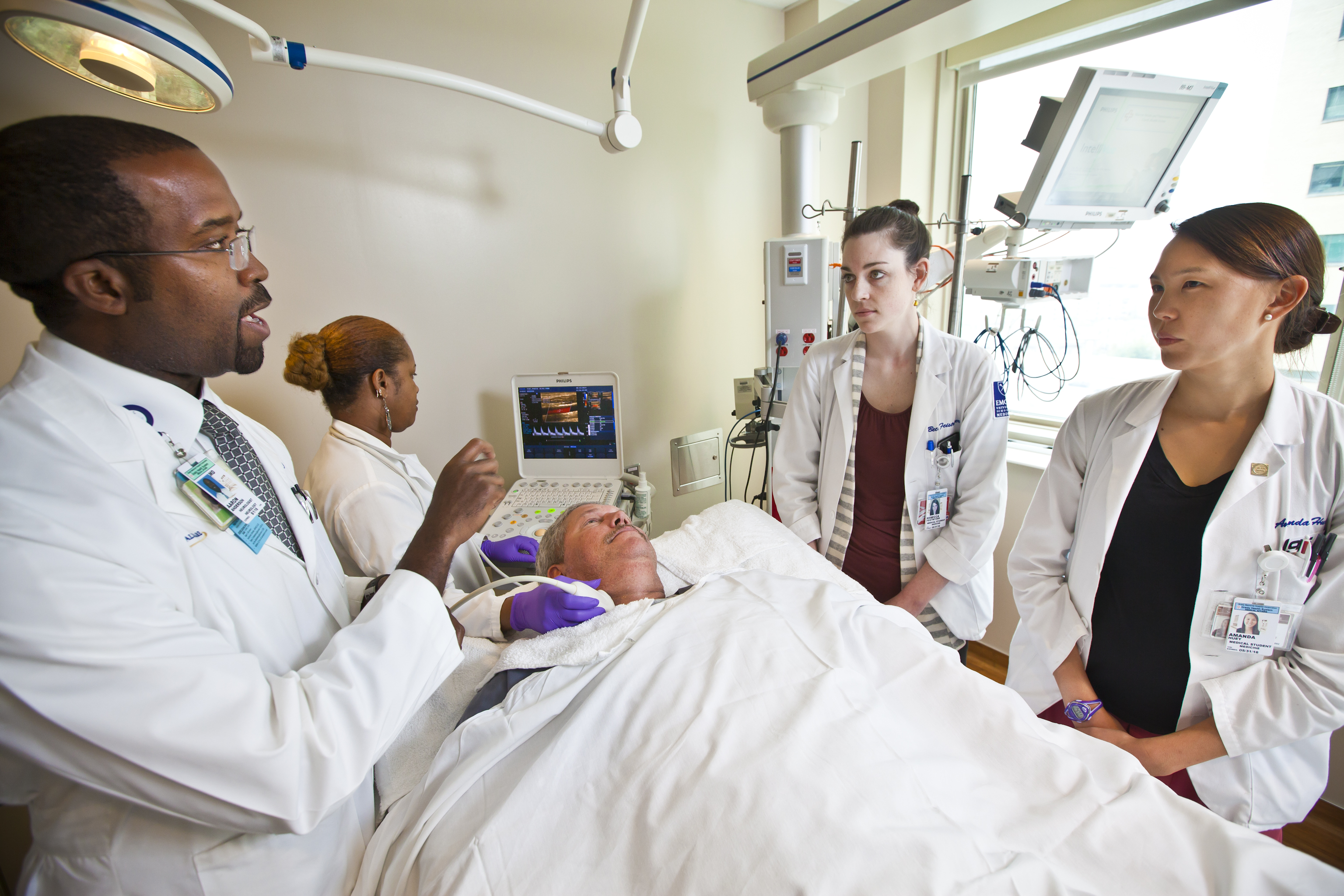 Instructor and students at bedside with patient